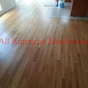 Solid oak flooring refinished with natural stain and 2 coats of water-based poly