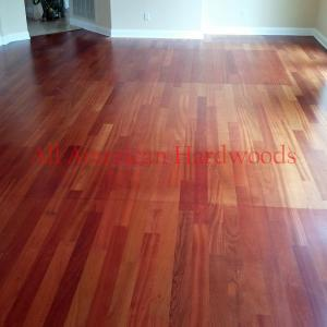 Brazillian Cherry Flooring with sun fading and extensive wear.